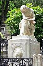 Chopin's tomb at Père-Lachaise, Paris with Clésinger's monument of a weeping woman (Jenny Lind, says Icons of Europe).